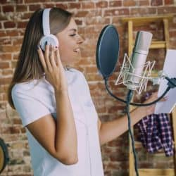 Recording song with music played in the background.