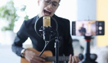Singer recording singing performance for Youtube.