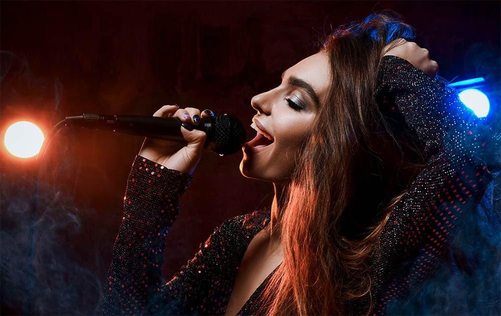 woman singing high notes